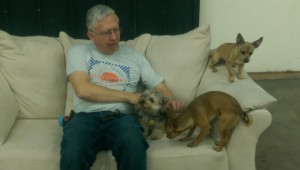 Dave snuggles with Toby, Chuco and Buddy in the Nuetral Zone.